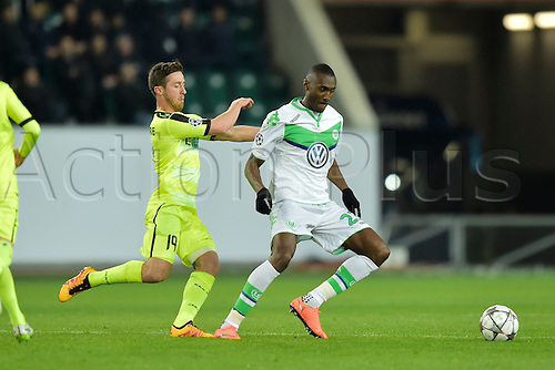 08.03.2016. Wolfsburg, Germany.  Dejaegere Brecht midfielder of KAA Gent fights for the ball with Josuha Guilavogui midfielder of VfL Wolfsburg during the Champions League Round of 16, second leg match between VfL Wolfsburg and KAA Gent at the Volkswagen Arena in Wolfsburg, Germany.