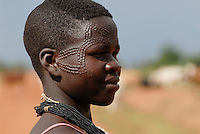 UGANDA Karamoja , Karimojong a pastoral tribe , young woman with facial ornament / UGANDA Karamoja , Volk der Karimojong , junge Frau mit Gesichtsverzierung und Schmuck