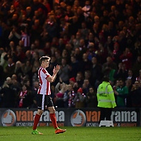 Lincoln City's Sean Raggett applauds the fans at the end of the game<br /> <br /> Photographer Chris Vaughan/CameraSport<br /> <br /> Vanarama National League - Lincoln City v Chester - Tuesday 11th April 2017 - Sincil Bank - Lincoln<br /> <br /> World Copyright &copy; 2017 CameraSport. All rights reserved. 43 Linden Ave. Countesthorpe. Leicester. England. LE8 5PG - Tel: +44 (0) 116 277 4147 - admin@camerasport.com - www.camerasport.com