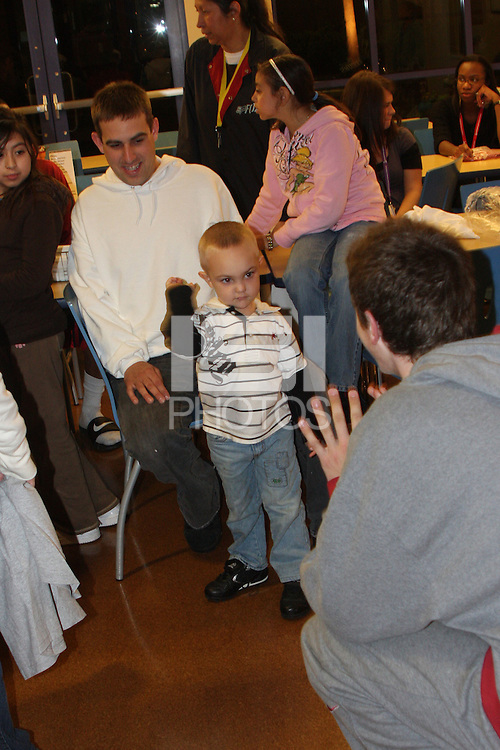 PALO ALTO, CA - DECEMBER 16:  Elliott Bullock and the Stanford Cardinal visit the Ronald McDonald House for the holidays on December 16, 2008 in Palo Alto, California.