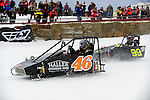 David Haller (46) of Wahpeton, ND and Ian Hodgson (99) of Pembroke, ON race their Outlaw 600 sleds during the AMSOIL World Championship Snowmobile Derby in Eagle River, WI, Jan. 19, 2014.