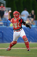 Batavia Muckdogs catcher Chad Wallach (55) throws to first for an out during a game against the Hudson Valley Renegades on August 7, 2013 at Dwyer Stadium in Batavia, New York.  Batavia defeated Hudson Valley 15-6.  (Mike Janes/Four Seam Images)