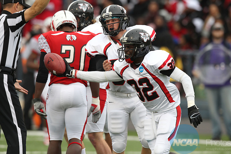 15 DEC 2012:  Amel Magwood (32) is all smiles as he hands the ball to the referee after recovering a fumble against Winston-Salem State University during the Division II Men's Football Championship held at Braly Municipal Stadium in Florence, AL. Valdosta defeated Winston-Salem 35-7 to win the national title. Tim Clark/NCAA Photos