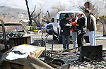 Patrick and Jeannie Watts talk with insurance representatives Saturday, Jan. 21, 2012 after their Pleasant Valley home was destroyed by Thursday's brush fire. Jeannie's mother, June Hargis, 93, was the only fatality in the fire which destroyed 29 homes..Photo by Cathleen Allison