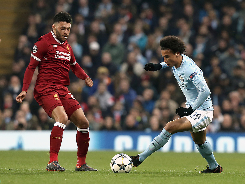 Manchester City's Leroy Sane looks to run past Liverpool's Alex Oxlade-Chamberlain<br /> <br /> Photographer Rich Linley/CameraSport<br /> <br /> UEFA Champions League Quarter-Final Second Leg - Manchester City v Liverpool - Tuesday 10th April 2018 - The Etihad - Manchester<br />  <br /> World Copyright &copy; 2017 CameraSport. All rights reserved. 43 Linden Ave. Countesthorpe. Leicester. England. LE8 5PG - Tel: +44 (0) 116 277 4147 - admin@camerasport.com - www.camerasport.com