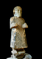 Pictures & images of the South Gate Hittite sculpture statue of Hittite Storm God Tarhunzas ( Tarḫunz Tarḫunna or in Hurrian Teshub or in Phoenician Baal Krntrys ). 8th century BC. Karatepe Aslantas Open-Air Museum (Karatepe-Aslantaş Açık Hava Müzesi), Osmaniye Province, Turkey. Against black background