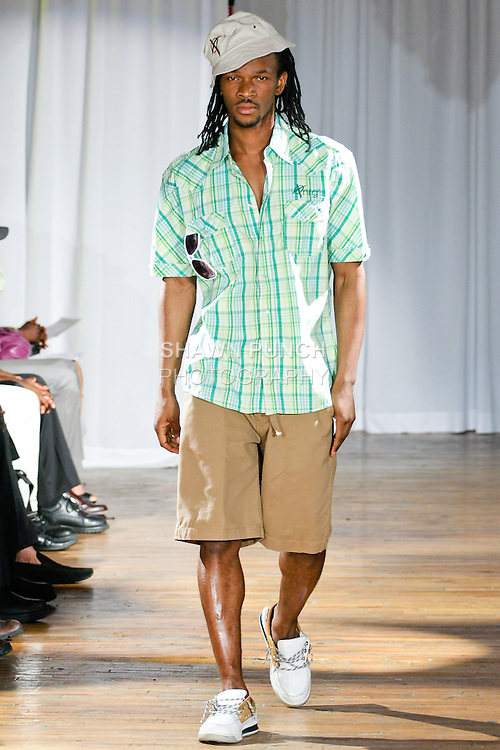 Model walks the runway in a Positive NRG outfit by Ron Cooke, during the Ray Vincente Menswear Showcase 2010 fashion show at Chacala Loft on June 18, 2010.