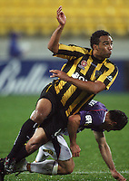 Perth's Mile Sterjovski fouls Paul Ifill during the A-League football match between Wellington Phoenix and Perth Glory at Westpac Stadium, Wellington, New Zealand on Sunday, 16 August 2009. Photo: Dave Lintott / lintottphoto.co.nz