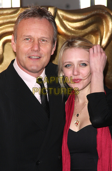 ANTHONY & EMILY HEAD.EA British Academy Children's Awards 2010 at the Hilton Hotel, Park Lane, London - .November 28th 2010.bafta baftas half length black suit jacket red hand father dad daughter scarf family.CAP/ROS.©Steve Ross/Capital Pictures