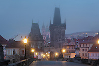 The Mala Strana or Lesser Quarter double bridge towers at the entrance to the Charles Bridge or Karluv most, built 1357 - 15th century, Prague, Czech Republic. The bridge's construction began under King Charles IV, replacing the old Judith Bridge built 1158'??1172 after flood damage in 1342. This new bridge was originally called the Stone Bridge (Kamenny most) or the Prague Bridge (Prazsky most) but has been the Charles Bridge since 1870. The bridge is 621m long and nearly 10m wide, resting on 16 arches shielded by ice guards. It is protected by three bridge towers, two on the Lesser Quarter side and one on the Old Town side. The historic centre of Prague was declared a UNESCO World Heritage Site in 1992. Picture by Manuel Cohen