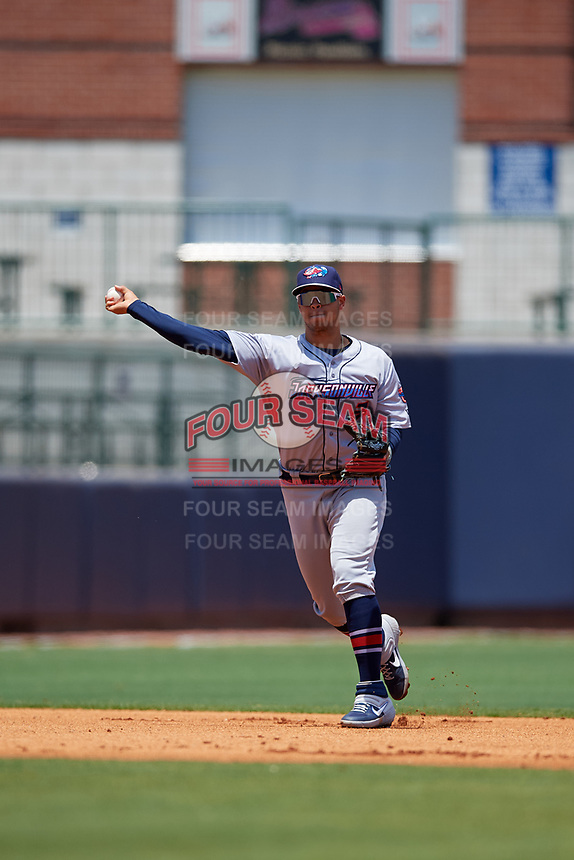 Jacksonville Jumbo Shrimp shortstop Joe Dunand (3) throws to first base during a Southern League game against the Mississippi Braves on May 5, 2019 at Trustmark Park in Pearl, Mississippi.  Mississippi defeated Jacksonville 1-0 in ten innings.  (Mike Janes/Four Seam Images)