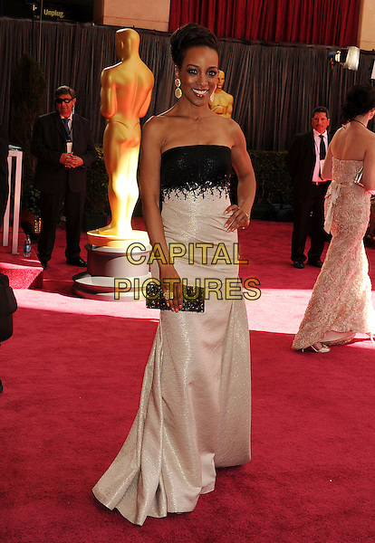 Shaun Robinson.85th Annual Academy Awards held at the Dolby Theatre at Hollywood & Highland Center, Hollywood, California, USA..February 24th, 2013.oscars full  length dress top skirt white clutch bag gold hair up strapless hand on hip black.CAP/ROT/TM.©Tony Michaels/Roth Stock/Capital Pictures