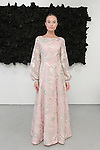 Marketa poses in a blush/gold/sage floral embroidered flowing long sleeved gown from the Barbara TFank Spring Summer 2016 collection, at a fashion show presentation in the Leila Heller Gallery during New York Fashion Week Spring Summer 2017, on September 12, 2016.