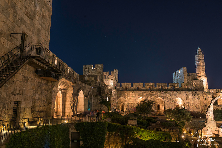 The Tower of David or the Citadel in the Armenian Quarter of the Old City of Jerusalem at dusk with its minaret.  The Old City of Jerusalem and its Walls is a UNESCO World Heritage Site