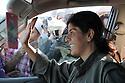 Iraq 2009 .One of the PKK guerillas on a peace march to Turkey waves at the supporting crowd. .Irak 2009 .Une combattante du PKK en route pour la frontiere turque salue la foule de ses sympathisants..