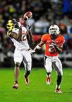 Kevin Dorsey of the Terrapins hauls in the ball for 52-yard gain. Maryland defeated Miami 32-24 during a game at the Byrd Stadium in College Park, MD on Monday, September 5, 2011. Alan P. Santos/DC Sports Box