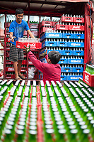 Unloading a Coca Cola truck,Street Photography, Manila, Philippines