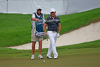Damien McGrane (IRL) and caddy John Hort line up his putt on the 17th green during Friday's Round 2 of the 2011 Barclays Singapore Open, Singapore, 11th November 2011 (Photo Eoin Clarke/www.golffile.ie)