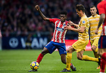 Thomas Teye Partey (L) of Atletico de Madrid competes for the ball with Bernardo Jose Espinosa Zuniga of Girona FC during the La Liga 2017-18 match between Atletico de Madrid and Girona FC at Wanda Metropolitano on 20 January 2018 in Madrid, Spain. Photo by Diego Gonzalez / Power Sport Images