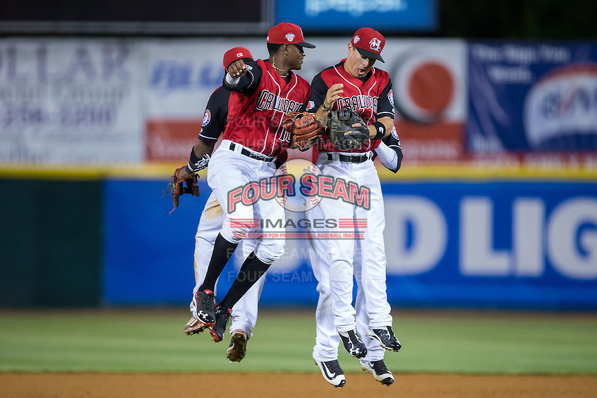 (L-R) Yeyson Yrizarri (2), Ti'Quan Forbes (10), Dylan Moore (6) and Frandy De La Rosa (back) celebrate their win over the Lexington Legends at L.P. Frans Stadium on April 29, 2016 in Hickory, North Carolina.  The Crawdads defeated the Legends 6-2.  (Brian Westerholt/Four Seam Images)
