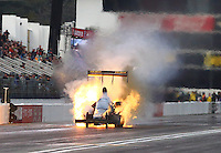 Feb 11, 2017; Pomona, CA, USA; NHRA top fuel driver Troy Buff explodes an engine on fire during qualifying for the Winternationals at Auto Club Raceway at Pomona. Mandatory Credit: Mark J. Rebilas-USA TODAY Sports