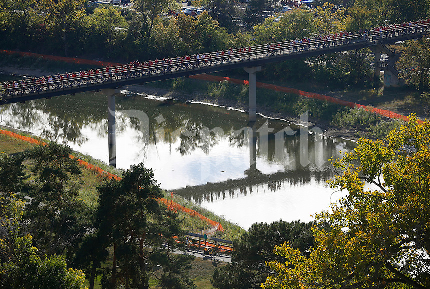 Ohio State fans cross the Olentangy River prior to the NCAA football game against the Cincinnati Bearcats at Ohio Stadium in Columbus on Sept. 27, 2014. (Adam Cairns / The Columbus Dispatch)