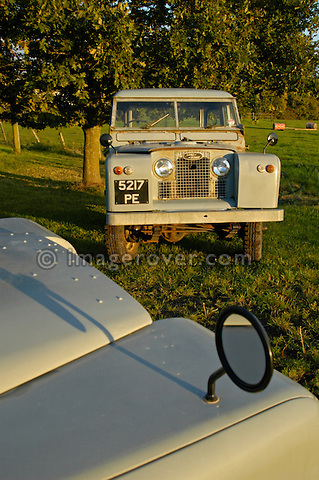A matching couple of two historic 1963 Landrover Series 2a's on a farm in Dunsfold, UK 2004. One being a hardtop, one a truckcab, and both in very original and full working condition. --- No releases available. Automotive trademarks are the property of the trademark holder, authorization may be needed for some uses.