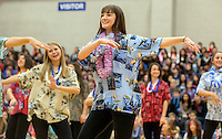 STAFF PHOTO JASON IVESTER --12/16/2014--<br /> Members of the Rogers High spirit squads dance to a Hawaiian medley on Tuesday, Dec. 16, 2014, during a ceremony inside the Rogers High gym. With support from the school's DECA program, Gunnison Riggins and his family were given a trip to Hawaii with the Make-A-Wish Foundation. Gunnison has been diagnosed with neuroblastoma.