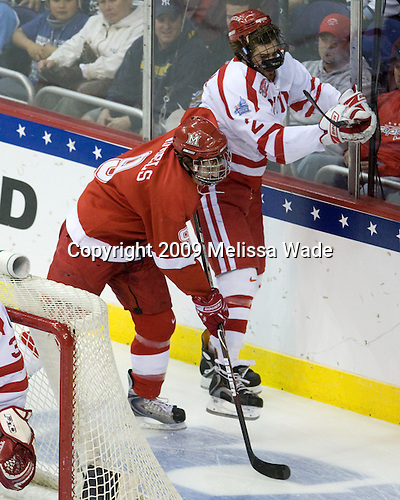 Tommy Wingels (Miami - 9), Eric Gryba (BU - 2) - The Boston University Terriers defeated the Miami University RedHawks 4-3 in overtime to win the 2009 NCAA D1 National Championship at the Frozen Four on Saturday, April 11, 2009, at the Verizon Center in Washington, DC.