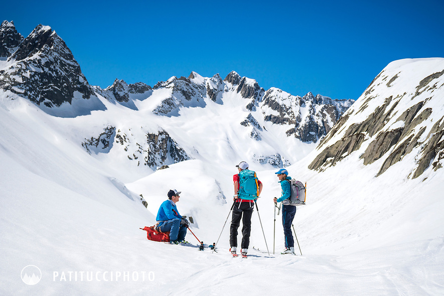 Ski tourers taking a break in the sun while on the way to the Bächlital Hut during the Berner Haute Route, Switzerland