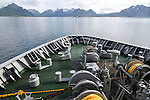 Hurtigruten ferry ship approaching the southern coast of Hinnoya Island, Nordland, northern Norway