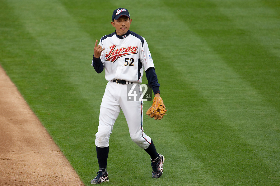 22 March 2009: #52 Munenori Kawasaki of Japan celebrates with teammates showing an hand sign during the 2009 World Baseball Classic semifinal game at Dodger Stadium in Los Angeles, California, USA. Japan wins 9-4 over Team USA.