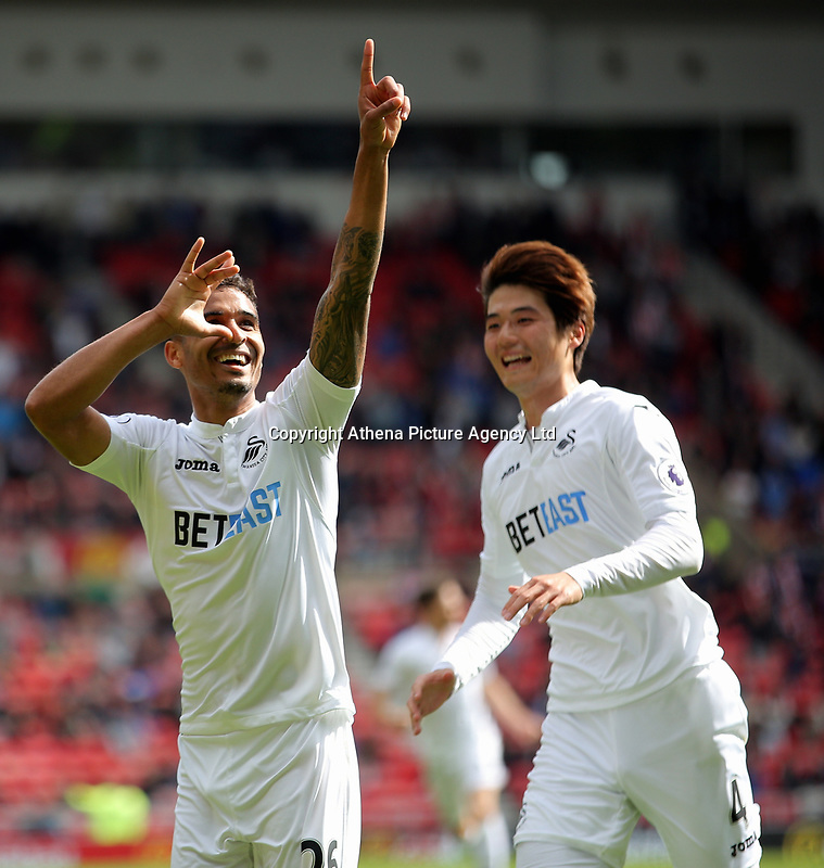 SUNDERLAND, ENGLAND - MAY 13: (L-R) Kyle Naughton of Swansea City celebrates his goal with team mate Ki Sung-Yueng during the Premier League match between Sunderland and Swansea City at the Stadium of Light, Sunderland, England, UK. Saturday 13 May 2017