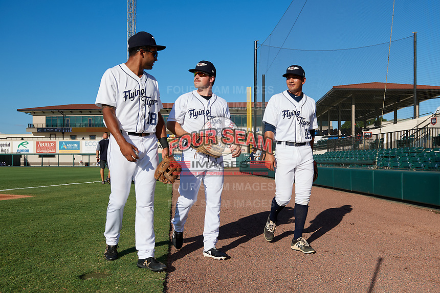 Lakeland Flying Tigers Derek Hill (18), Troy Montgomery (7) and John Valente (12) walk towards the dugout before a game against the Fort Myers Miracle on August 7, 2018 at Publix Field at Joker Marchant Stadium in Lakeland, Florida.  Fort Myers defeated Lakeland 5-0.  (Mike Janes/Four Seam Images)