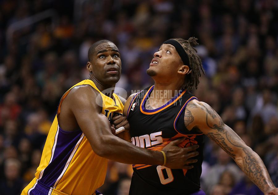 Jan. 30, 2013; Phoenix, AZ, USA: Los Angeles Lakers forward Antawn Jamison (left) against Phoenix Suns forward Michael Beasley at the US Airways Center. Mandatory Credit: Mark J. Rebilas-