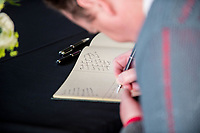 Thursday 18 May 2017<br /> Pictured: A man signs the book of condolences which has been places inside the 'Senedd', the Welsh Assembly Building in Cardiff Bay <br /> Re: Former Welsh first minister Rhodri Morgan has died, aged 77. Rhodri Morgan was elected as an MP in 1987 and became an AM when the assembly was created in 1999.