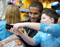 Pictured: Wayne Routledge has a selfie taken by a young boy at the till Wednesday 08 December 2016<br />Re: Swansea City FC players have bought Christmas gifts for 60 children at Smyths toy store in Swansea, south Wales.