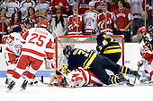 Kyle Bigos (Merrimack - 3) lands on top of Joe Pereira (BU - 6) - The Boston University Terriers defeated the Merrimack College Warriors 6-4 on Saturday, November 14, 2009, at Agganis Arena in Boston, Massachusetts.