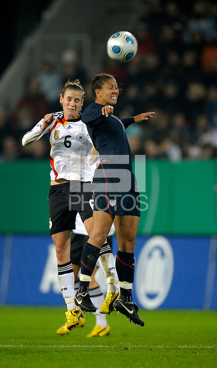 Shannon Boxx (7) heads the ball over Simon Laudehr (6). US Women's National Team defeated Germany 1-0 at Impuls Arena in Augsburg, Germany on October 27, 2009.
