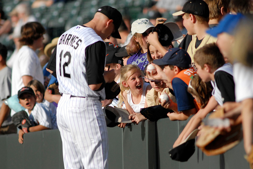 Colorado Rockies shortstop Clint Barmes signs autographs for young fans prior to a game against the San Francisco Giants. The Giants defeated the Rockies 6-5 at Coors Field in Denver, Colorado on May 20, 2008.