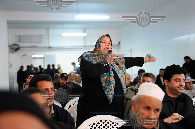 A citizen speaks at a General People's Congress meeting in El Zawia. The Congress was created by Colonel Muammar Al Gaddafi to allow political discussion.