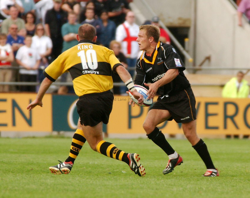 Photo. Jed Wee.Newcastle Falcons v London Wasps, Zurich Premiership, Kingston Park, Newcastle. 1-9-2002..Newcastle's Jonny Wilkinson (R) watched by Wasps' Alex King.