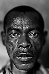 """MADAGASCAR, AMBANJA, MARCH 2013:.Radison Bienvenue, chief of security of the CINA cocoa plantation, was Murder the 12th of March 2013. Here the 17 supsects for the Murder, one of this man killed Radison, the """" WAR OF COCOA """" has started..Madagascar is home to some of the world's finest rich orange and red pods of cocoa, increasingly used today by Europe and America's finest chocolatiers.Raw cocoa beans, used to make premium chocolate, have never been in higher demand. A surge in appetite for high-end chocolate sourced from single-origin growers has created a frenzied rush for the """"dark gold""""..For the island's cocoa farmers, the surging demand for chocolate should be transformative, especially after years of poverty, but their newfound livelihoods are under threat from armed bandits running rampant in remote areas, hijacking stores and road shipments of the precious beans that make chocolate..In some villages, bandits have stolen hauls worth around $1,000 a fortune in one of the world's poorest countries..©Giulio Di Sturco"""