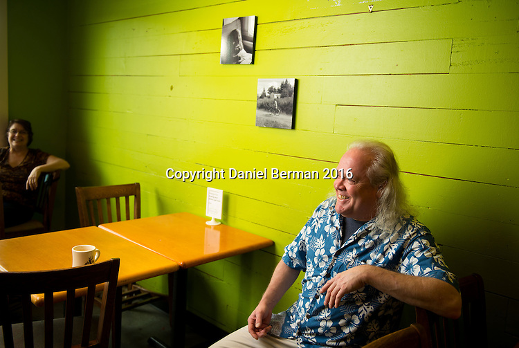 Nollies Cafe Owner Dan Munro at his South Lake Union bakery and coffeeshop, a fixture in the neighborhood for 43 years. Munro chats with some regulars at the cafe. Photo by Daniel Berman for Discover South Lake Union