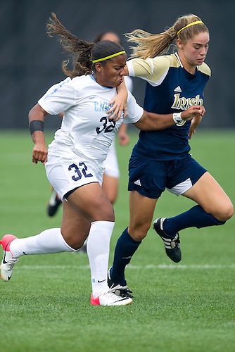 September 02, 2012:  Notre Dame forward Anna Maria Gilbertson (6) and North Carolina defender Meg Morris (32) battle for the loose ball during NCAA Soccer match between the Notre Dame Fighting Irish and the North Carolina Tar Heels at Alumni Stadium in South Bend, Indiana.  North Carolina defeated Notre Dame 1-0.