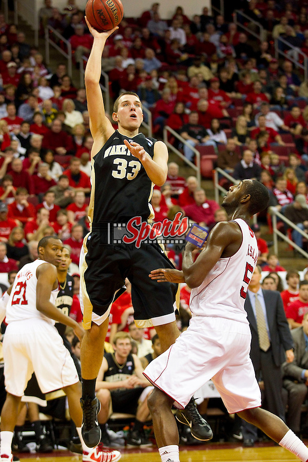 Carson Desrosiers #33 of the Wake Forest Demon Deacons floats a shot over CJ Leslie #5 of the North Carolina State Wolfpack at the RBC Center on January 8, 2011 in Raleigh, North Carolina.  The Wolfpack defeated the Demon Deacons 90-69.  Photo by Brian Westerholt / Sports On Film