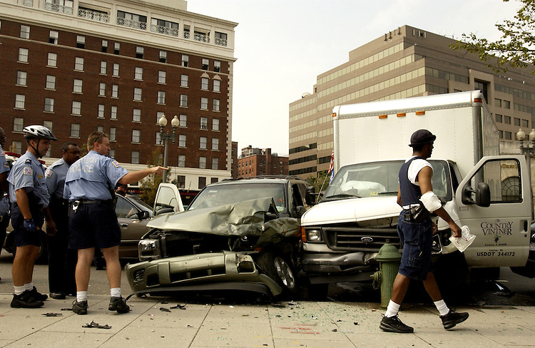 DC Metropolitan Police recount an incident in which a stolen truck crashed at North Capitol and Massachusetts Ave., and the suspect was dragged from the vehicle and apprehended.  The suspect appears on the ground.  Metropolitan Police made the arrest.