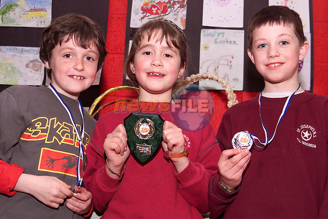 Zach Archbold, 3rd, Julia Ashe, 1st and Conor Thornton, 2nd in the 2nd class section of Mell School art competition..Picture: Paul Mohan/Newsfile