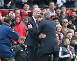 Arsene Wenger manager of Arsenal shakes hands with Jose Mourinho manager of Manchester United during the premier league match at the Old Trafford Stadium, Manchester. Picture date 29th April 2018. Picture credit should read: Simon Bellis/Sportimage