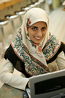 2005, Montreal Qc) CANADA<br /> Model Released photo<br /> Young Muslim woman from Irak wear the hidjab while doing her school work an a laptop computer in a Montreal, CANADA coffee shop<br /> Photo : (c) 2005 Pierre Roussel